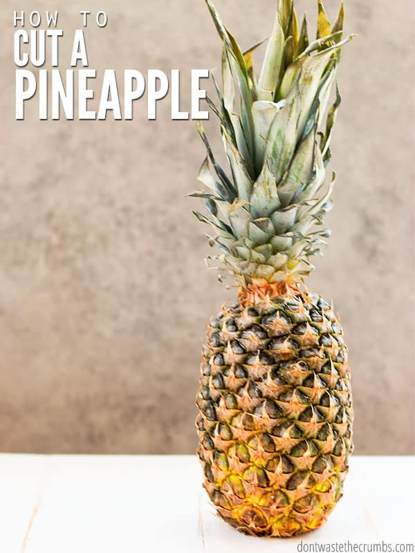 "A fresh pineapple. Text overlay says, ""How to Cut a Pineapple."""