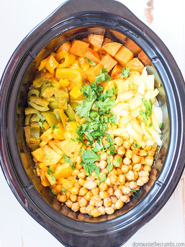 Pineapple Thai Curry in a slow cooker, lots of vegetables! Sweet potatoes, peppers, pineapple, garbanzo beans.