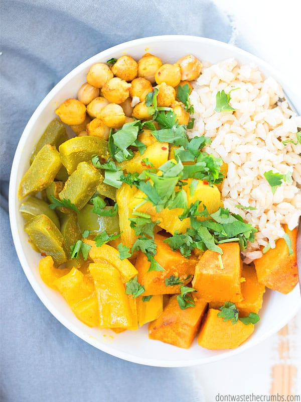 Crockpot Pineapple recipe, Vegetable Thai Curry with rice in a bowl topped with ciliantro