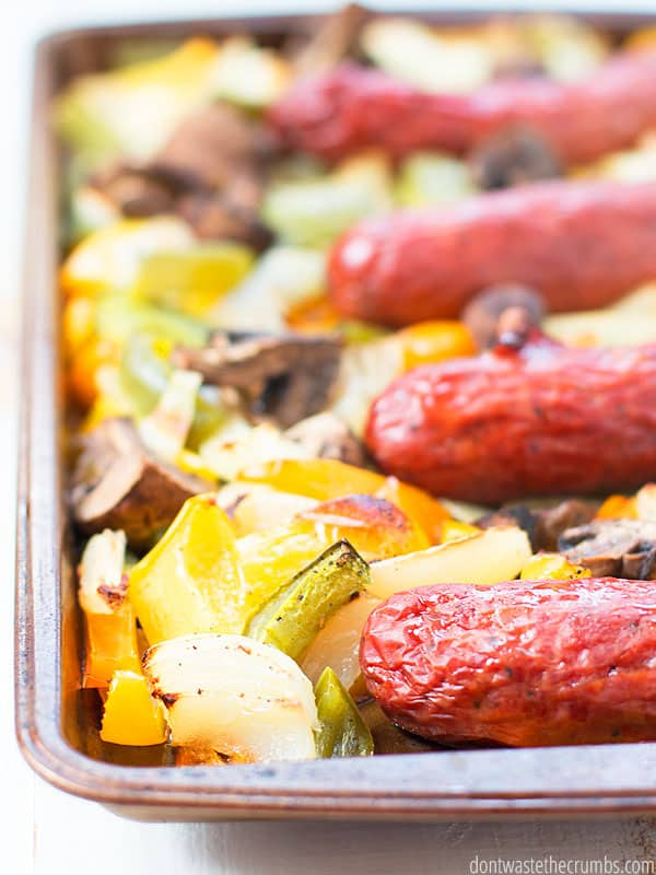Sausages in a sheet pan with peppers, onions, and mushrooms. A yummy dinner recipe.