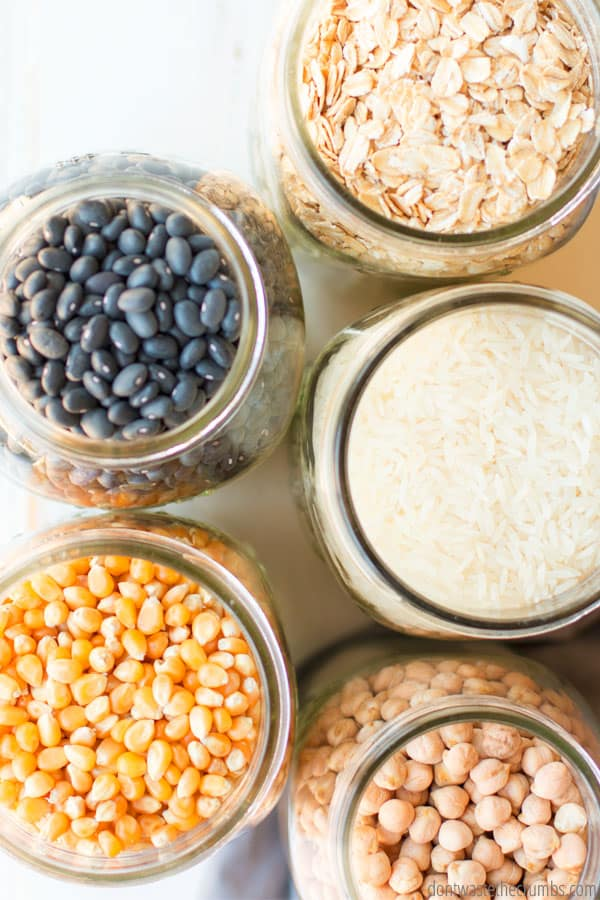 What is Batch cooking? Ways to save time and money with batch cooking. Jars of black beans, oatmeal, rice, corn, and garbanzo beans.