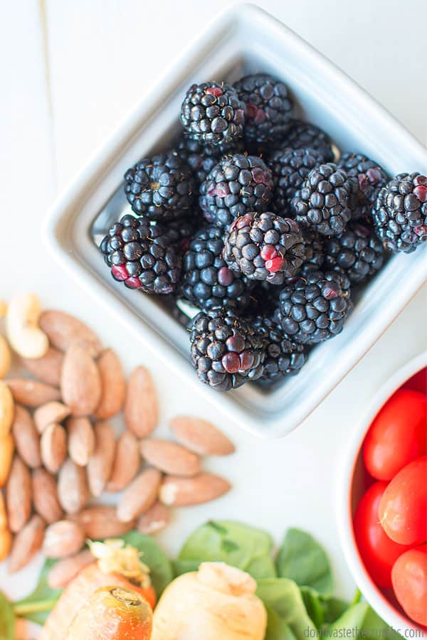 Ways to save money on food on a tight budget. Image shows blackberries and almonds.
