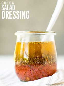 This is the BEST Greek salad dressing recipe! So easy, healthy, and a traditional flavor that's better than store-bought! Add yogurt to make it creamy! :: DontWastetheCrumbs.com