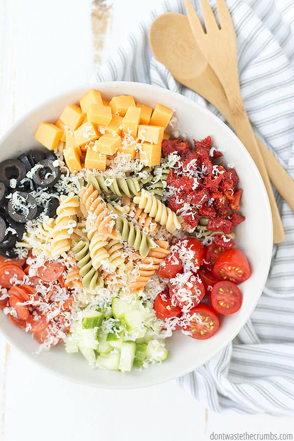 Overhead view of how to make Italian pasta salad