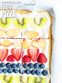 This healthy fruit pizza is one of our favorite easy desserts and uses less sugar in the sugar cookie crust and cream cheese frosting, making each individual square serving less calories! :: dontwastethecrumbs