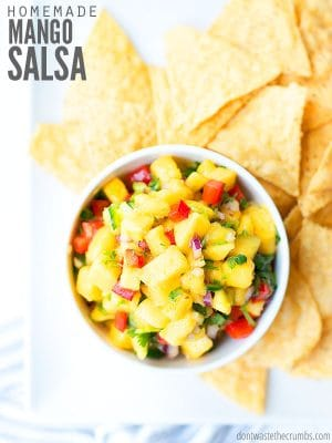 Enjoy this fresh mango salsa recipe with chips, salmon, fish, chicken, or use in tacos! Make it with or without cilantro/avocado/tomato for an easy dinner. :: DontWastetheCrumbs.com