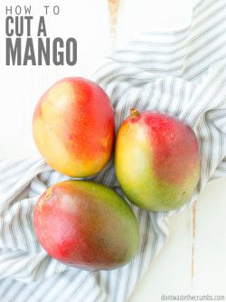 Easiest method for how to cut a mango without a peeler or peeling it! My favorite hack to cut it in half, slice it or dice it, without a glass or cup! :: DontWastetheCrumbs.com