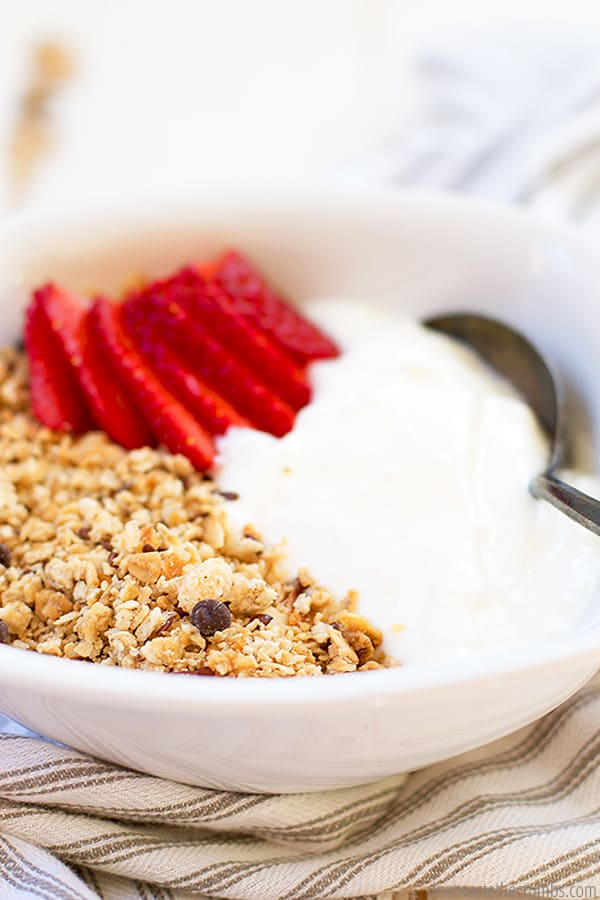 This easy homemade yogurt recipe uses only 2 ingredients, whole milk and starter culture. That's it! Pair it with sliced fruit and granola for a delicous snack!