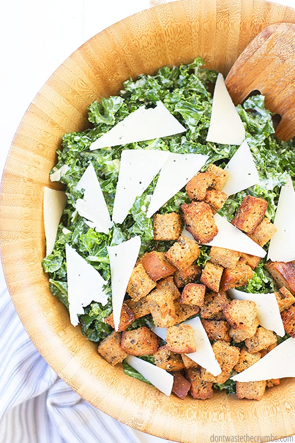 Adding some sliced chicken would be perfect to make a chicken Caesar salad with this kale recipe. Dress with your favorite dressing, croutons and parmesan cheese! ::dontwastethecrumbs.com