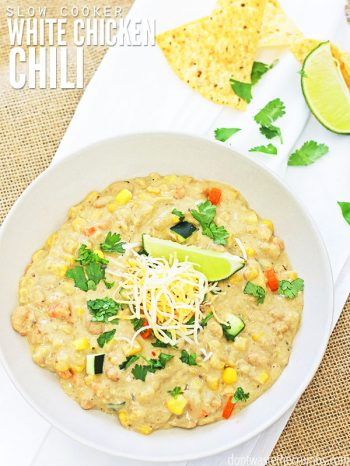 My family loves this easy recipe for slow cooker white chicken chili. Toss it all in the pot, set it to low and let the slow cooker make a delicious, kid-friendly dinner for you! This recipe is freezer-friendly and can easily be doubled for a crowd! :: DontWastetheCrumbs.com