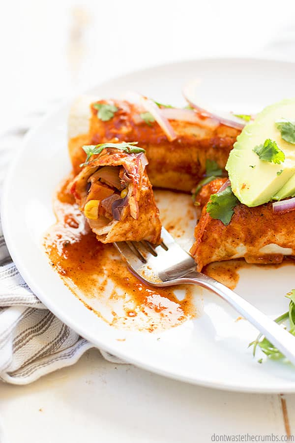 Enjoy every bite of this recipe for Sweet Potato Black Bean Enchiladas. Homemade enchilada sauce and black bean and taco filling make this recipe so delicious! Add toppings like shredded cheese, lime crema, cilantro and avocado!