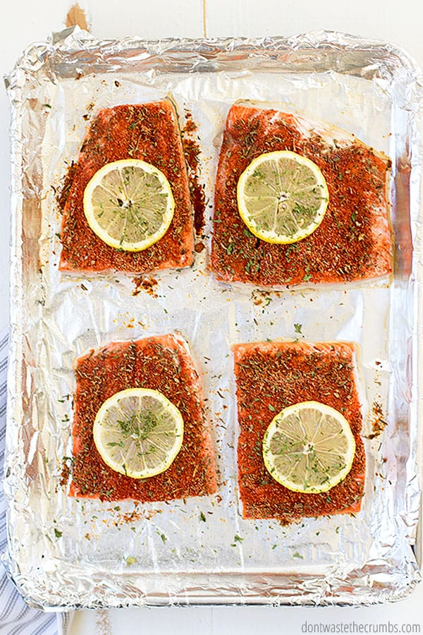 Top these flavorful and spicy salmon fillets with a lemon round for tangy brightness.