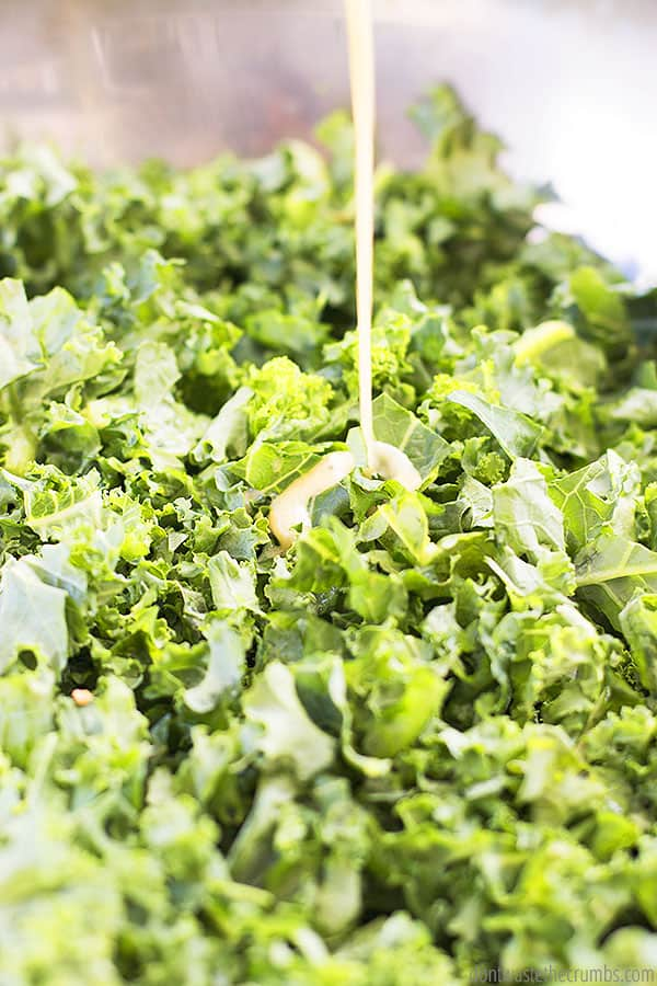 Massaging this kale with the dressing is the perfect way to take the bitterness out of the kale, which makes it SO delicious!