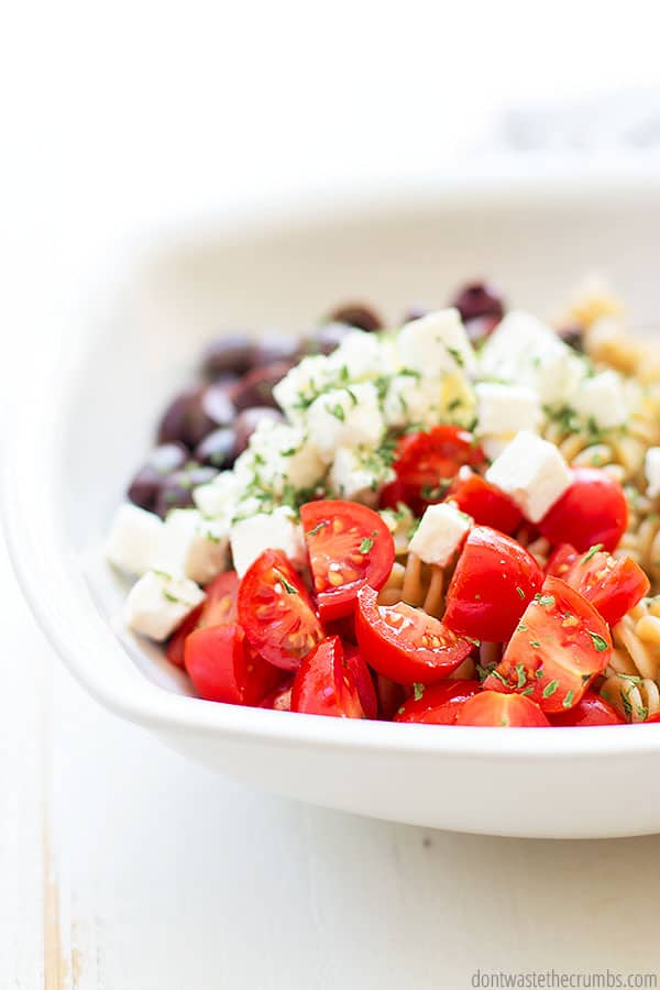 This Greek pasta salad is made with homemade greek dressing and topped with delicious feta cheese. Perfect salad to bring to a get together!