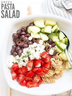 Simple and delicious Greek pasta salad with homemade Greek salad dressing. The perfect dish to bring to a pot luck, picnic or when you don't want to spend all day cooking! :: DontWastetheCrumbs.com