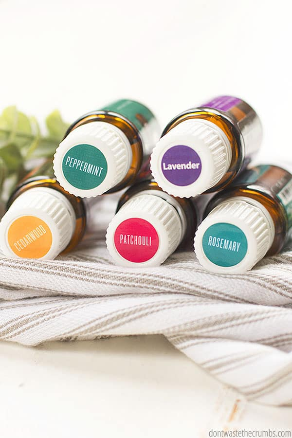 Use the essential oils of peppermint, lavender, cedarwood, patchouli and rosemary as featured in this photos. The five bottles are stacked up and labeled.