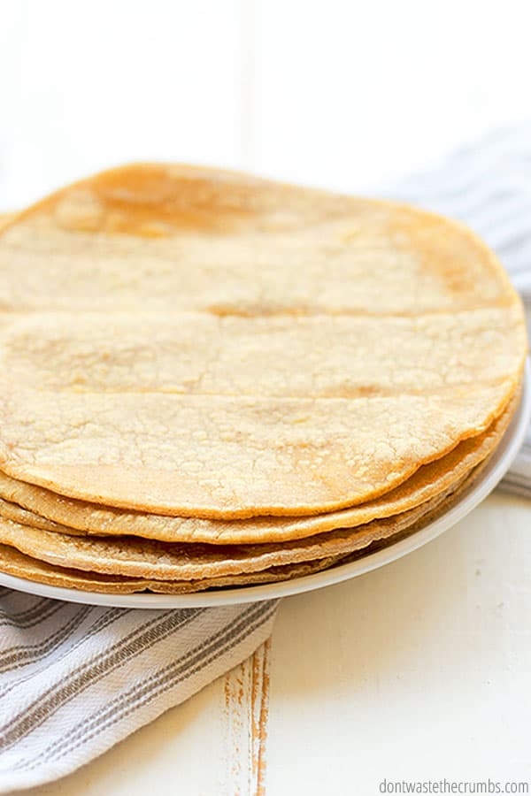 You can use either store-bought or leftover homemade tortillas to make homemade tortilla chips. It's a perfectly delicious way to save on food waste!