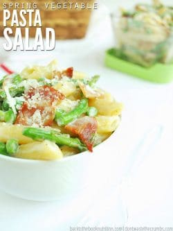 This 30-minute recipe for Spring vegetable pasta salad is easy to make! Use veggies like asparagus & peas, make this vegan, or add bacon. Serve hot or cold! :: DontWastetheCrumbs.com