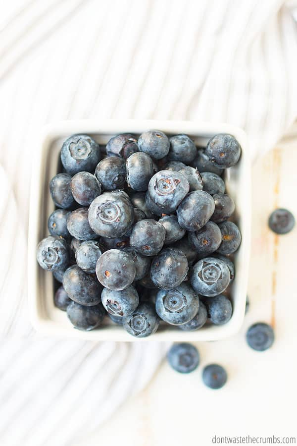A carton as seen from above filled with delightful and juicy blueberries which can be use for salads, smoothies, or desserts.