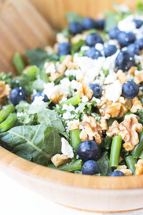 This kale salad is made with massaged kale - simply massage the homemade balsamic vinaigrette into the raw kale.