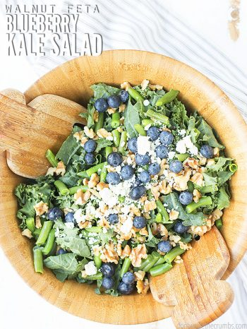 Easy recipe for kale salad made with massaged raw kale, blueberries, walnuts, feta, & balsamic vinaigrette. Serve with chicken or as is - great for summer!