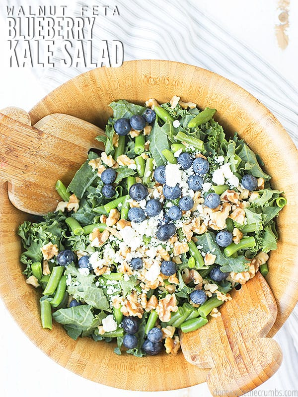 This kale salad with blueberries, walnuts, and feta is so easy to make and super versatile! You can customize about every ingredient based on what's in season or what you have on hand!