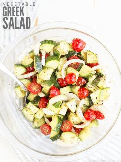 Learn how to make this easy recipe for traditional Mediterranean greek salad! Made with simple ingredients & homemade dressing. You can add chicken, too! :: DontWastetheCrumbs.com