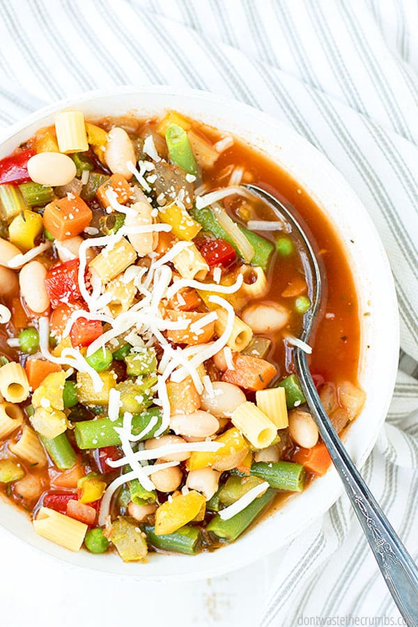 A delicious and easy minestrone soup that comes together quickly with fresh vegetables and pantry ingredients. Top with Parmesan cheese for a great finish!