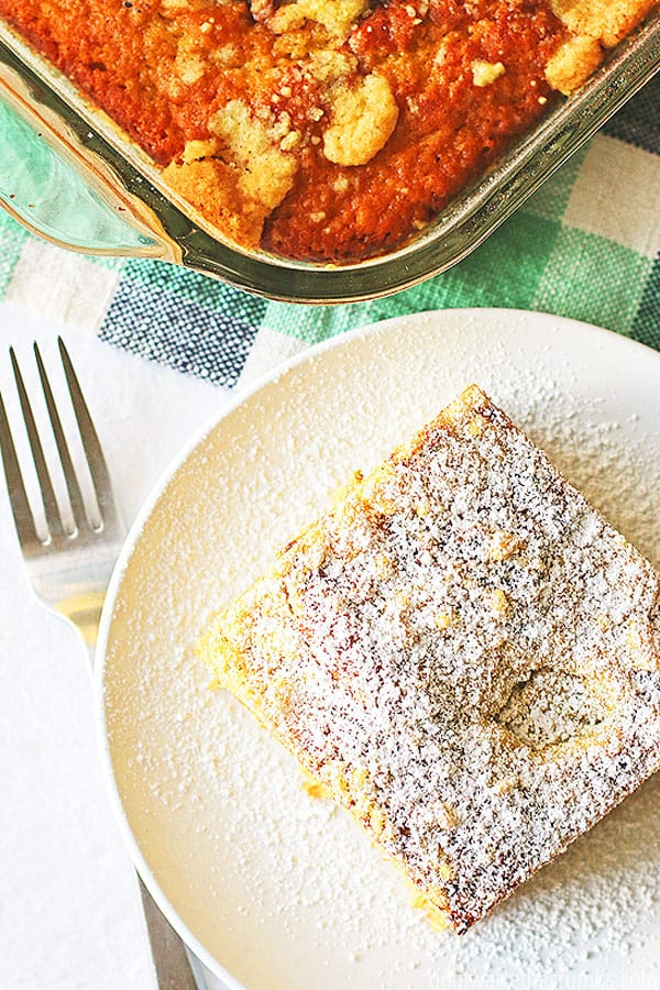 A delicious square of Einkorn coffee cake with powered sugar sprinkled all over the top.