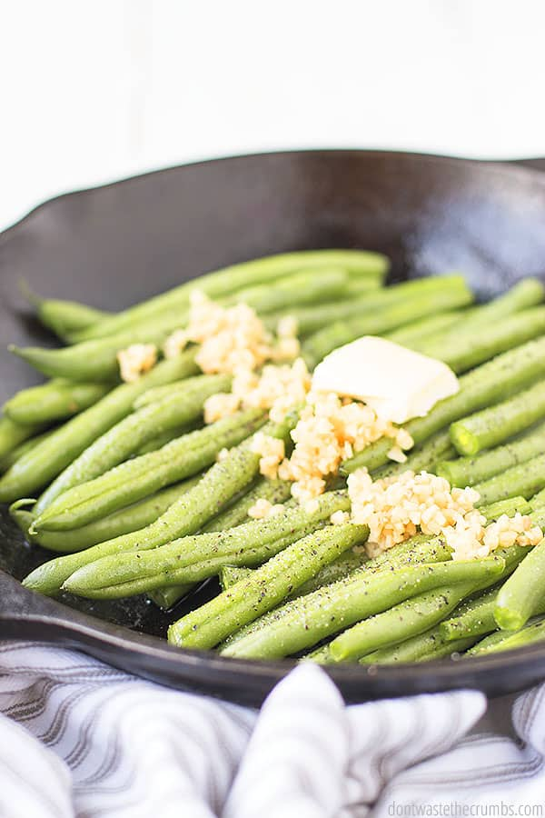 Sautéed buttery garlic green beans make the perfect side for our almond crusted chicken.
