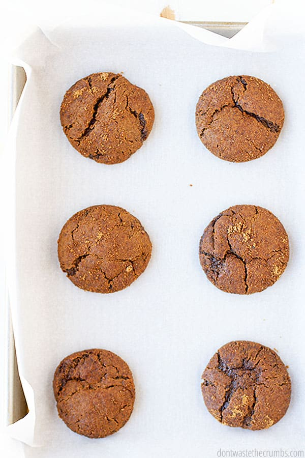 Cooked on a baking sheet and parchment paper these chewy gingersnap cookies come out with a gooey center and crisp crust.