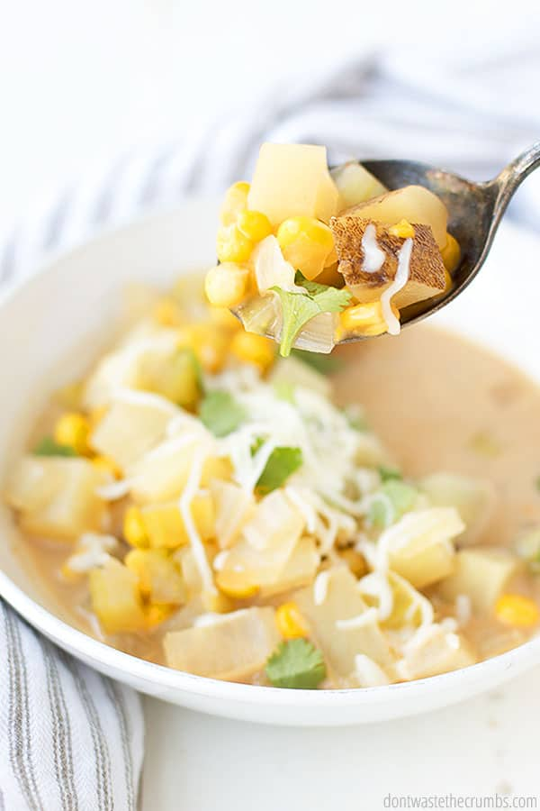 Each spoonful of this Mexican Potato Soup contains bursts of flavor from the corn kernels, diced potatoes, onions, celery, shredded cheese, and fresh cilantro.