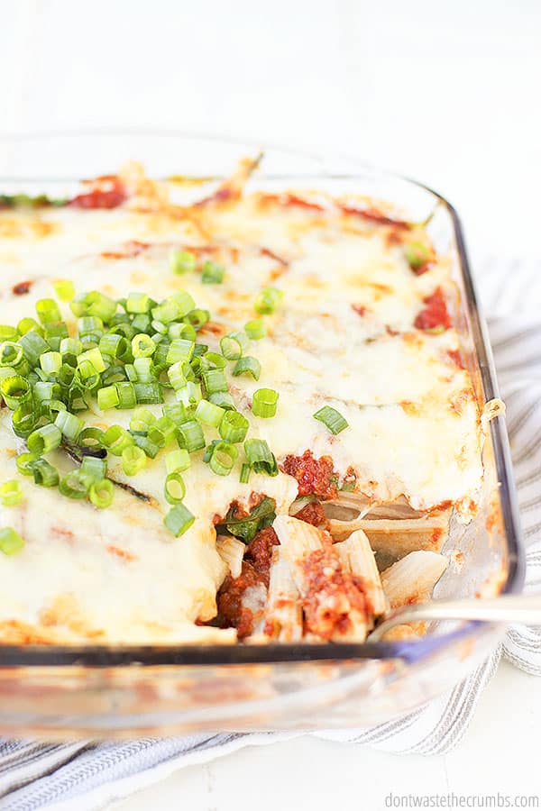 Easy and healthy baked ziti is sure to be a family favorite at the table. It is topped with some chopped chives and ready to be served!