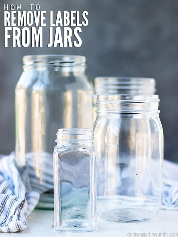 Love this awesome kitchen hack! Learn the simple DIY trick to remove labels from jars. The image shows four differing size and spotless jars by a towel.