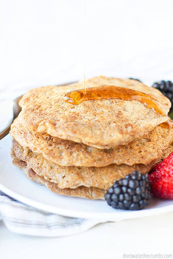 These easy and healthy oatmeal pancakes are yummy and sure to be a morning staple. Paired on the side are strawberries, blackberries, and kiwi. Drizzled with some maple syrup on top.