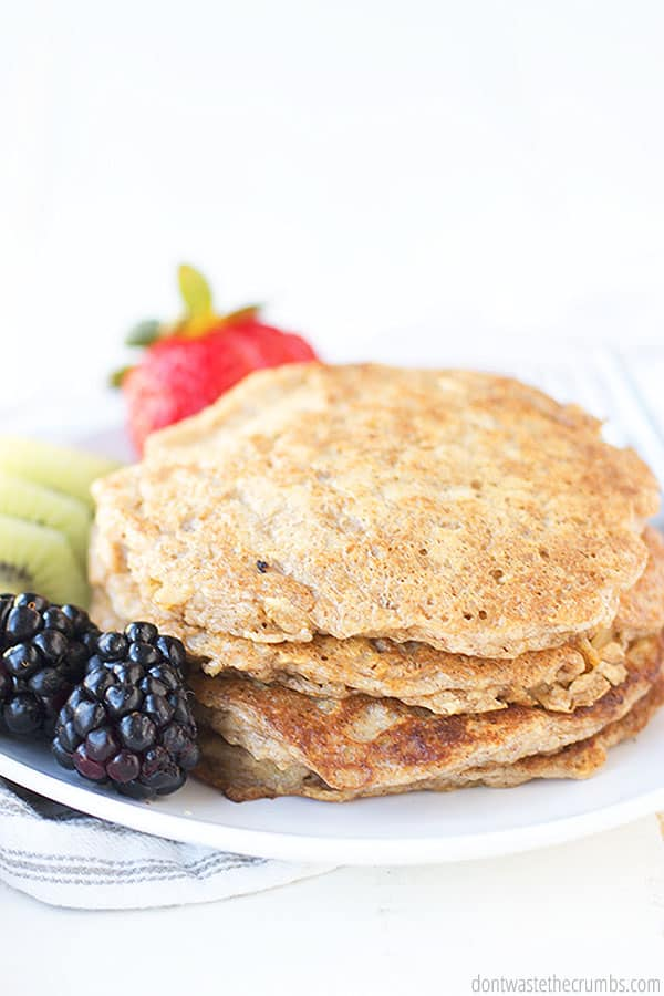 These soft and healthy oatmeal pancakes are delicious paired with fresh fruit. Paired along with blackberries and kiwi and strawberries.