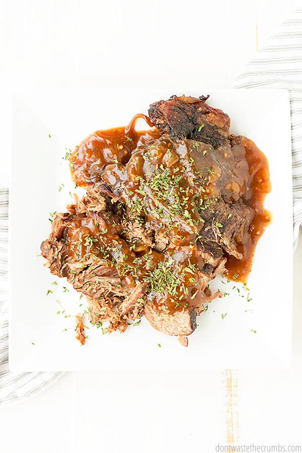This easy soft and tender slow cooker brisket tastes delicious with herbs sprinkled on top!
