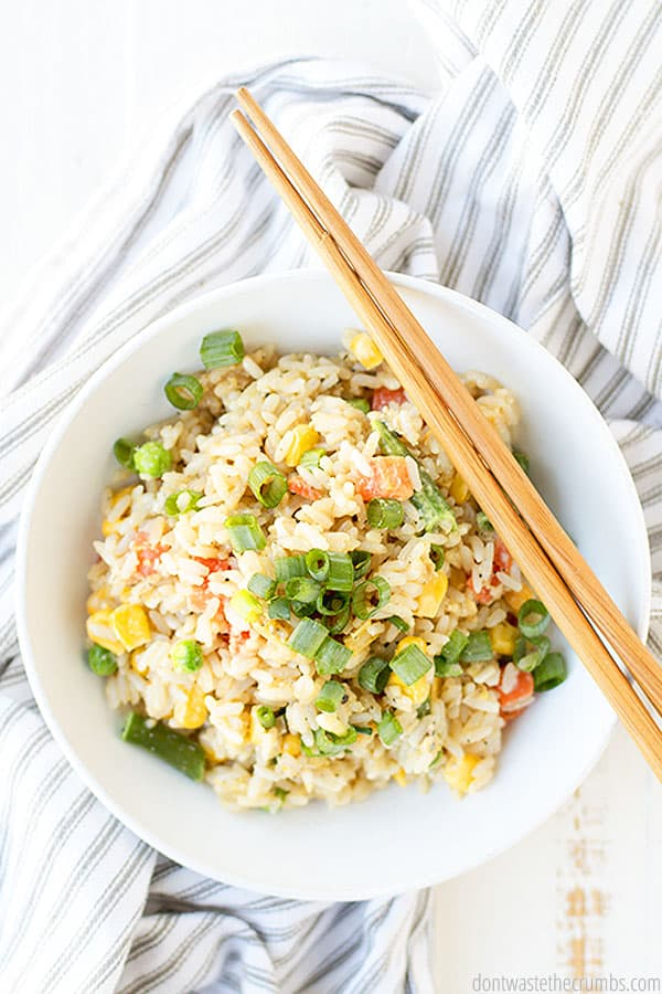 A full bowl of fried rice complete with many amazing vegetables and none of the unneeded unhealthy additives.