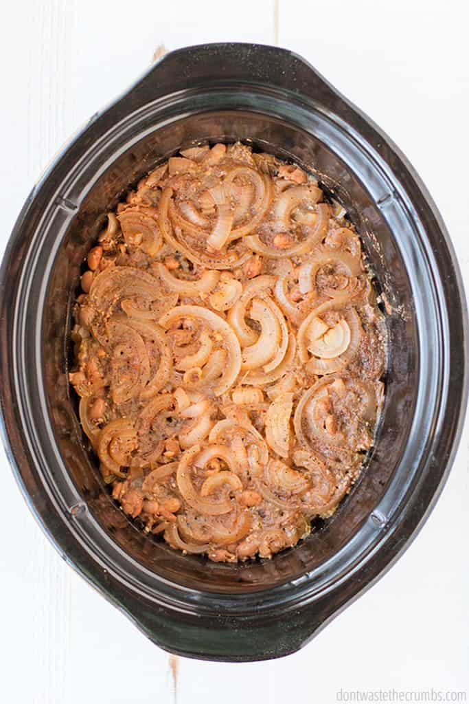 All you need for this crock pot refried beans are pinto beans, onion, jalapeno, garlic, salt, pepper, cumin, and water! It's all in the pot and ready to cook!