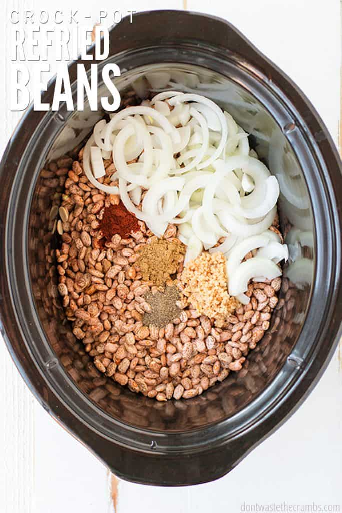 Skip the canned beans and learn how to make this authentic & easy crockpot refried beans recipe! Use dry or canned beans, or make refried black beans! Great for burritos made with cilantro lime rice and homemade tortillas.