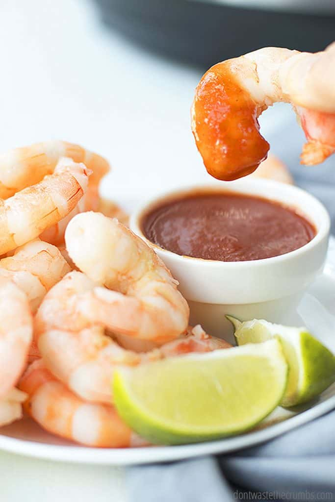 Try this easy shrimp instant pot recipe with dipping sauce and two lime wedges on the side.