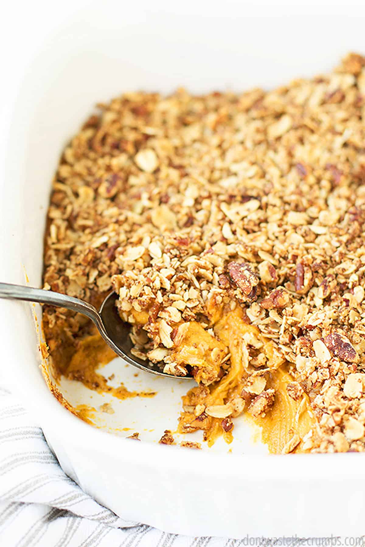A freshly baked sweet potato casserole with nut topping. Ground flax seeds are used as an egg replacer in this recipe.