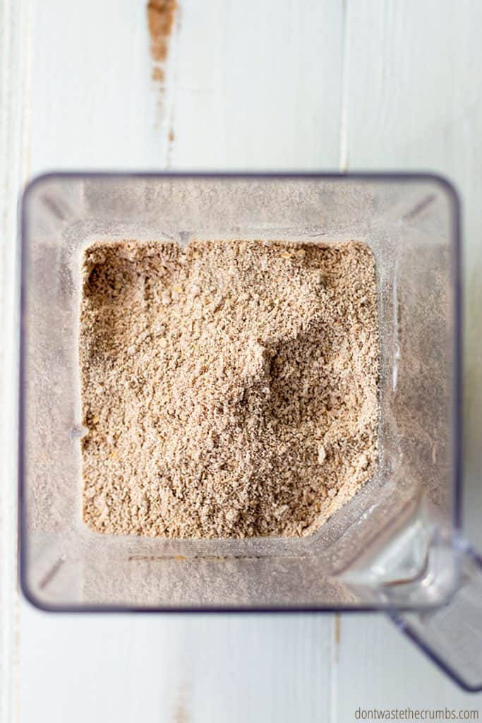 Freshly blended oat flour with other dry ingredients such as cinnamon in a blender.