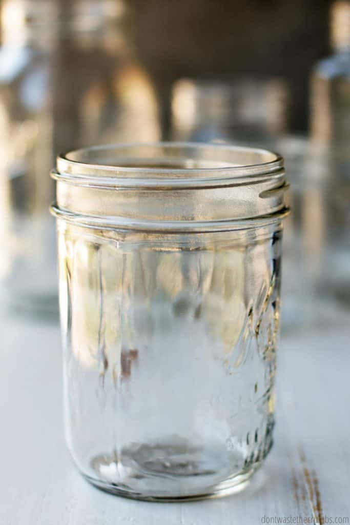 This pint size mason jar has straight edges and a wide mouth.