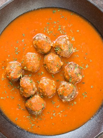 These delicious meatballs are sitting in tasty sauce within a pan. Try this simple meatball recipe with your favorite pasta dinner, or pack it for lunch. It's freezer-friendly, versatile, and takes only 15 minutes to make!