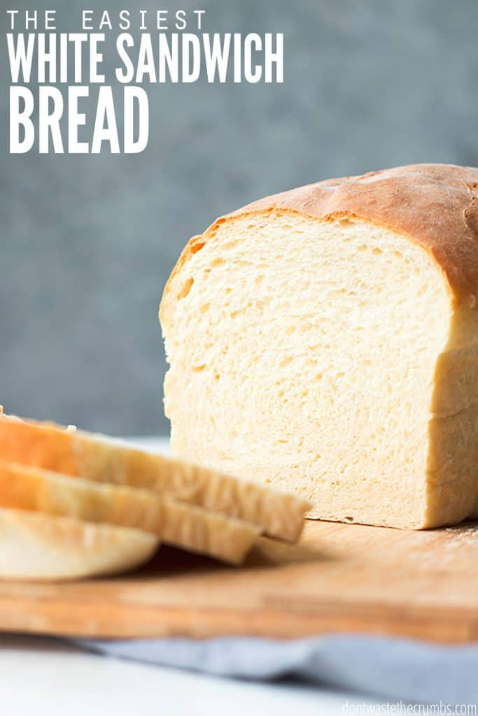"""A sliced homemade white sandwich bread with the text overlay, """"The Easiest White Sandwich Bread Recipe."""""""
